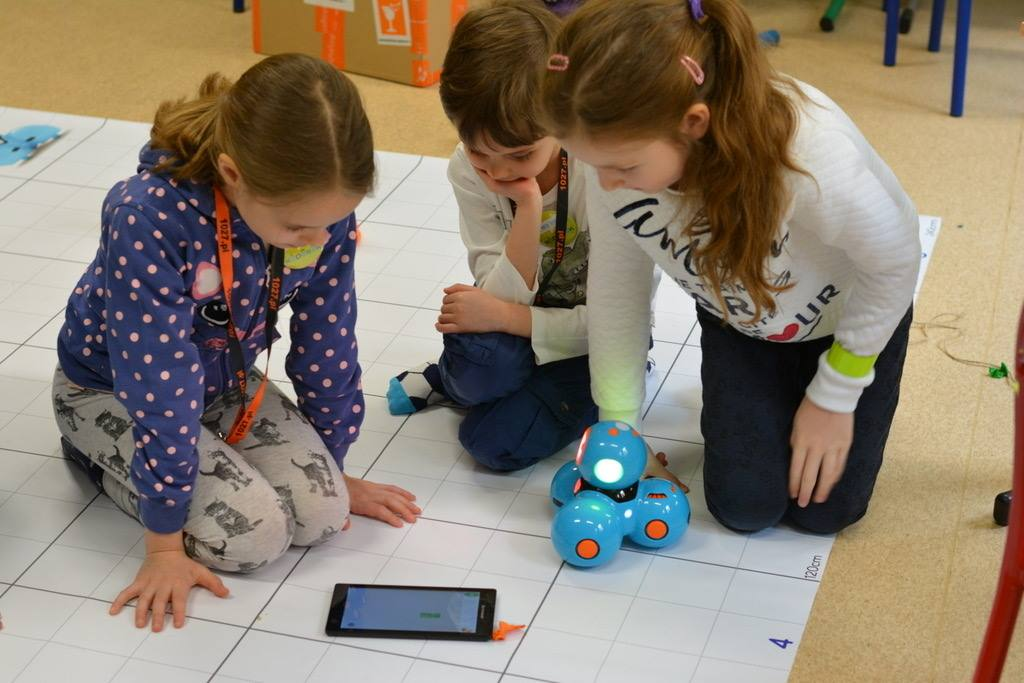Children interact with a programmable robot