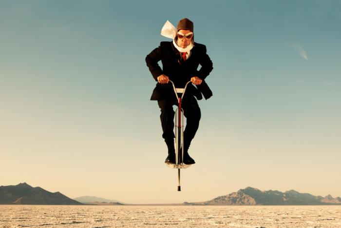 man jumps on a pogo stick